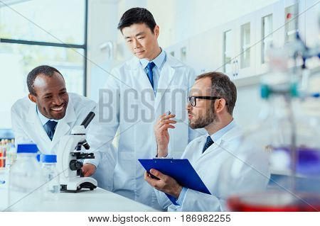 Young Doctors In Uniform Working At Testing Laboratory, Laboratory Technicians