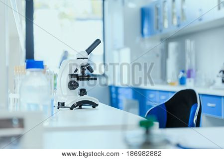 Microscope on table with laboratory equipment in chemical lab clean room laboratory concept