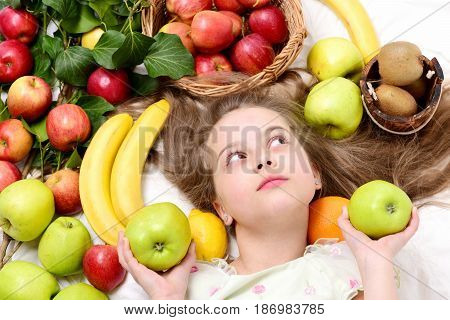 Little Happy Girl Or Cute Hungry Child Eating Colorful Fruit