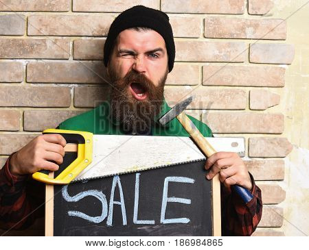 Bearded Worker Man Holding Various Building Tools With Satisfied Face