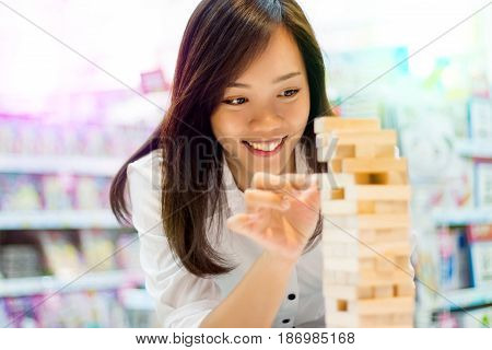 Asian Lady Play Jenga Game