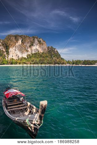 KRABI, Thailand - February 3, 2014: Traditional longtail boats on Railay beach, Thailand