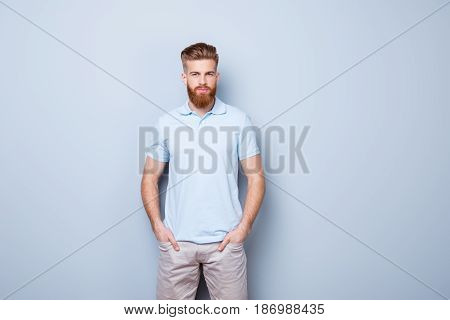 Confident Serious Handsome Red Bearded Young Man In Casual Stylish Outfit, Standing On The Pure Back