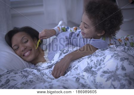 Son tickling sleeping mother