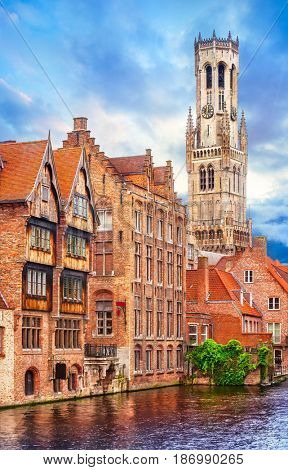 Medieval bell tower Belfort van Brugge in town Bruges Belgium vintage house on bank channel old Europe landscape.