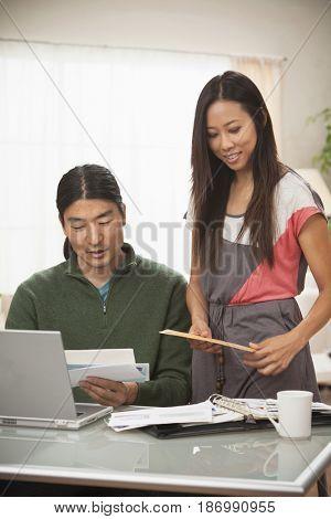 Korean couple paying bills together