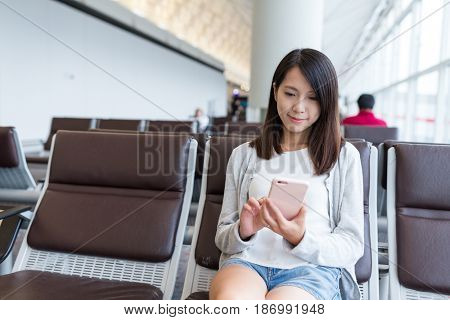Woman sue of mobile phone in airport
