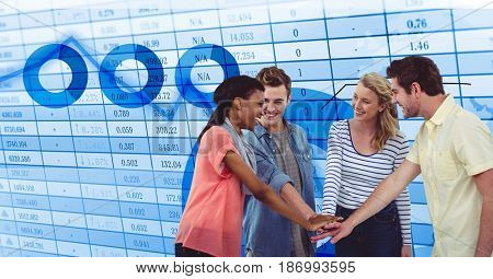 Digital composite of Casual business people stacking hands against data