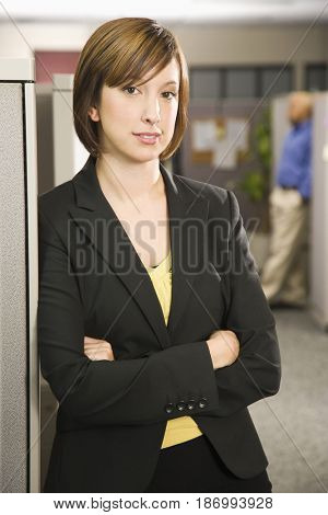 Caucasian businesswoman standing in office