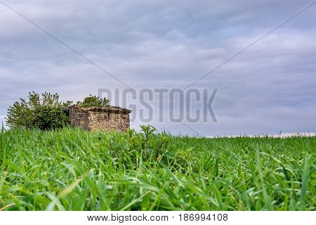 French countryside. Old stone house on a field.