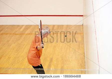 Hispanic man playing racquetball