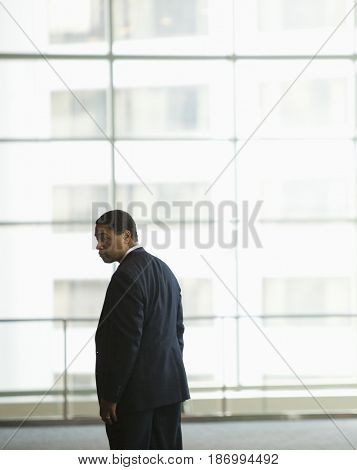 African American businessman standing in lobby