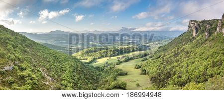 French countryside. View over the mountains (Trois Becs, Plateau des Chaux, Grand Barry et la Servelle) of the Drôme in France.