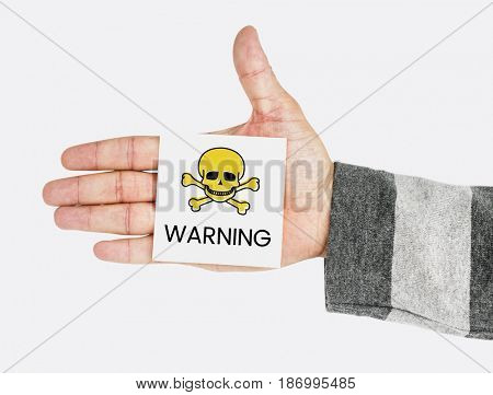 Hand showing memo with skull icon and dangerous toxin word