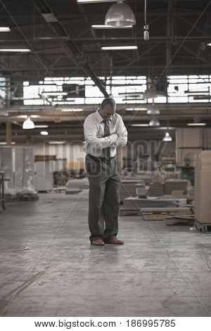 Black businessman standing in warehouse