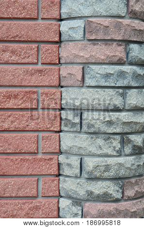 Conjugation of a brick wall with a corner column, built of another type of brick.