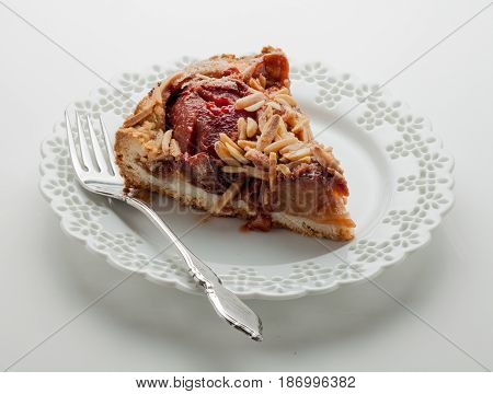 Serving of German Plum Cake with almond topping.