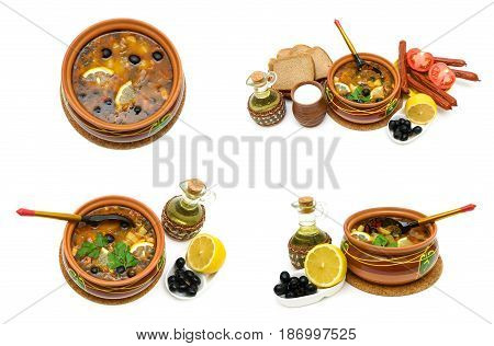 Dish of russian hodgepodge soup in ceramic pot and other foodstuffs on white background. horizontal photo.