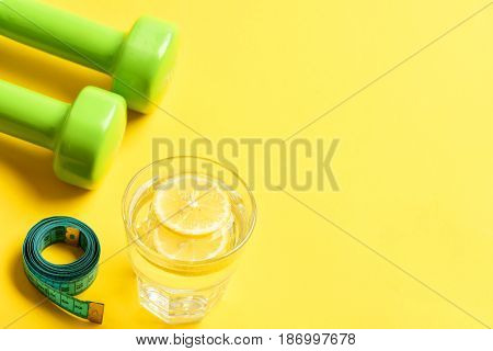 Measurement With Dumbbells, Measuring Tape And Water With Lemon