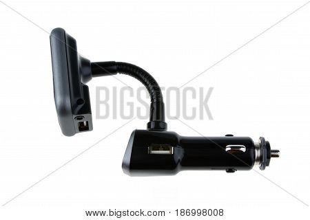 Mp3 Fm transmitter with remote control isolated on white background. It plays mp3, you listen on fm channel on car radio.