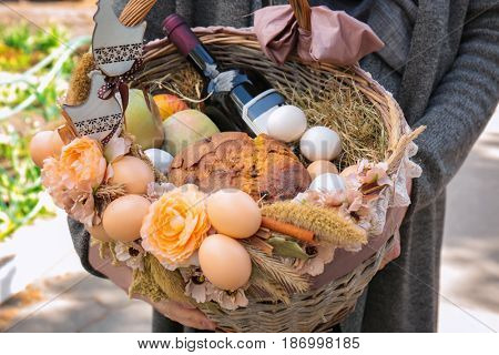 Man holding wicker basket with products outdoor