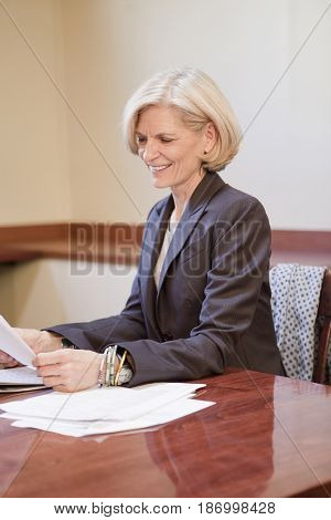 Caucasian businesswoman reading report