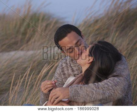 Hispanic couple getting engaged
