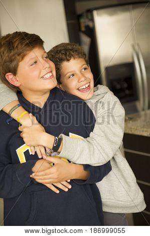 Hispanic boys hugging