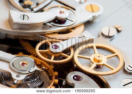 Stopwatch chronometer mechanism macro view. Cogs gears wheels mechanic connection concept. Macro view, selective focus.