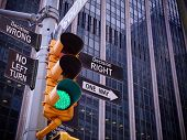 NYC Wall street yellow traffic light black pointer guide one way green light to Right decision way, no turn no way to wrong decision. One way to Right choice. Best choice, right choice. Wall street poster