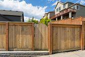 House backyard new wood fence garden gate door in suburban residential neighborhood poster