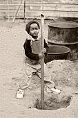 African kid, child labor, social issues, poverty poster