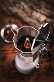 Percolated espresso coffee in a moka espresso pot poster
