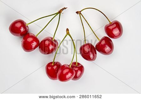 Set of ripe cherries on white background. Red natural berries. Summer fruity background. poster