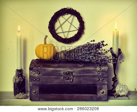 Lavender flowers bunch, pumpkin, old wooden box, candles and pentagram. Magic gothic ritual. Wicca, esoteric, divination and occult background with vintage objects poster