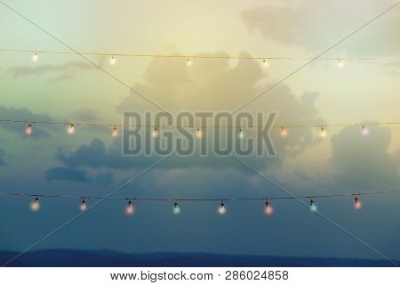 Colour String Lights With Bokeh Decor In Outdoor Party