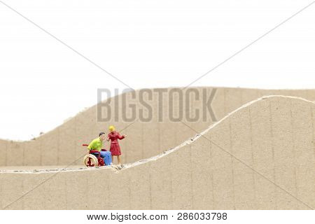 Miniature People Man In Wheelchair