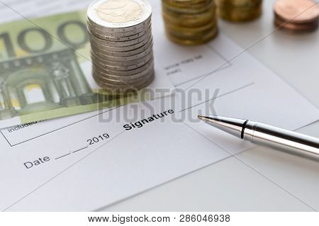 Signing A Document. Topics Of Cash Reward, Insurance Compensation, Financial Compensation.
