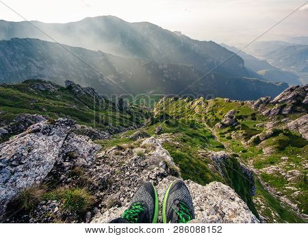 Person Standing On The Rock. Mountains Bucegi, Romania. Summer Day.