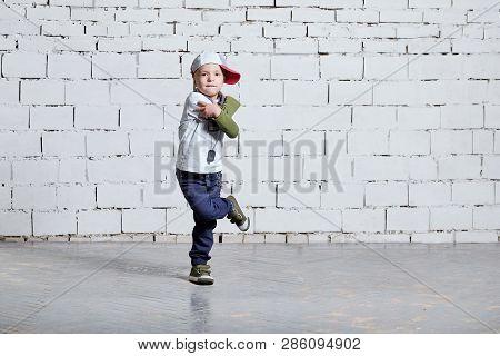 Child Boy Dancing. Cool Kid Hip Hop Break Dancing On Brick Wall Background. Little Man Movement, Exp