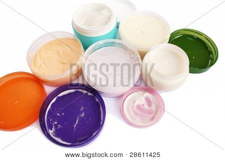 Cream jars isolated on white background, horizontal picture. poster