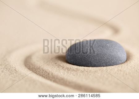 Balance harmony and equilibrium creating evenness. Zen stone meditation garden for spirituality and peace of mind body and soul. Minimalism peaceful background with sand texture