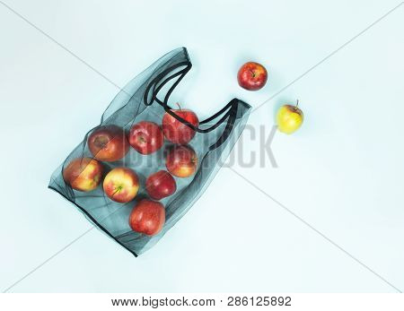 Top View Of Apples In A Reusable String Bag. Sustainable Eco Packaging Concept: Shopping For Groceri