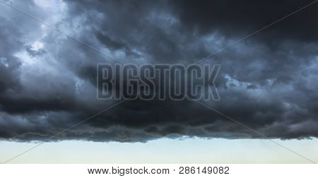 Dark Cloud With A Clear Edge Of The Storm Cloud, In Front Of A Thundery Front, Weather Changes