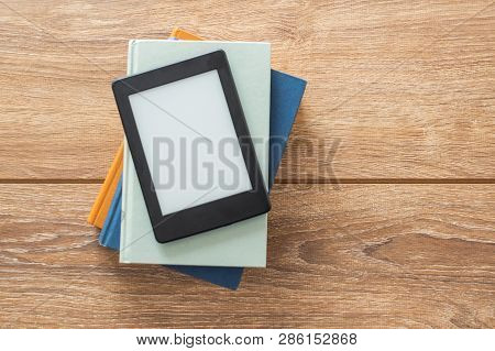 Ebook Reader Isolated On Wooden Table And Empty Copy Space