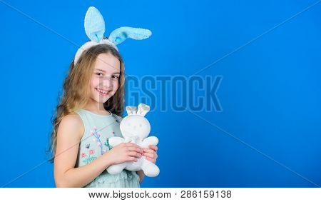 Easter Sunday. Small Kid With Cute Toy. Little Child In Easter Rabbit Style Playing With Toy. Easter