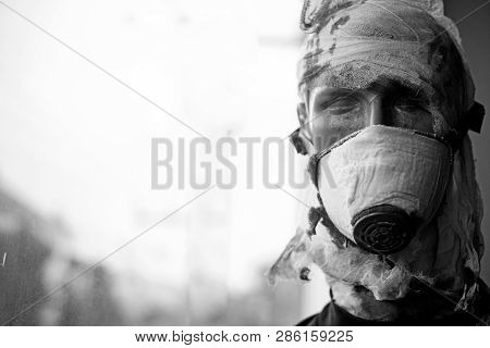 War is a crime against humanity. Dummy man wear gas mask against chemical attack. War victim dummy casualty. Dummy of war soldier. Victim of armed conflict. Badly wounded and injured, copy space. poster