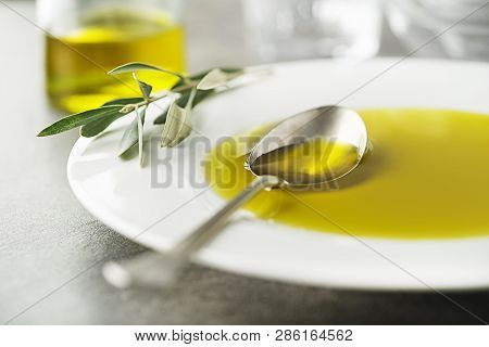 Healthy Olive Oil Pouring With Spoon Close Up-image Concept