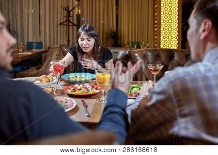 Woman Feeling Sick While Eating Bad Food In A Restaurant. Dinner Customer Having A Bad Experience Fe