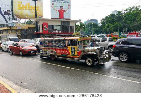 Cebu City, Philippines - October 1, 2018: Traffic On Street City At The Philippines. Typical Bus Jee